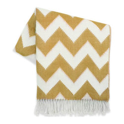 """Jonathan Adler - Jonathan Adler Zig Zag Camel Throw Blanket - Snuggle in style wrapped in this luxe throw blanket by modern design icon Jonathan Adler. Made from baby alpaca for an uber-soft feel, the fringed Zig Zag throw performs double duty accenting a sofa or bed with on-trend chevron. 63"""" x 63"""" ; Zig zag pattern in camel and natural ; 100% baby alpaca (the finest shearing from an adult); Dry clean only; Hand-loomed by Peruvian artisans; Sustainably produced with Aid to Artisans, a non-profit organization that connects designers in American with artisans in developing countries to promote fair trade"""