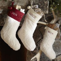 Faux Sheepskin Stocking - I bought these faux sheepskin stockings for my children a few years ago, and they are stunning. I prefer the white on white with the black monogram.