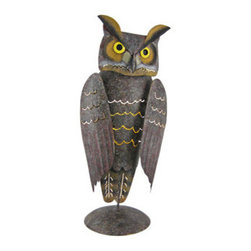 Hand Painted Metal Owl Votive Candle Holder - This beautiful hand painted metal owl votive candle holder is a great accent for bird lovers. It features small cutouts, accented with metallic gold paint, that lets the light from the votive shine through. Measuring 11 inches tall, 5 inches wide and 3 3/4 inches deep, the wings of the owl are mounted with springs, giving them a bobblehead effect when the owl is touched. It has a sponged, grayish-brown finish that compliments almost any decor. It makes a great gift.