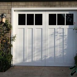 Traditional Wood Garage Doors - Traditional style Garage Doors represent traditional American architecture on both coasts. Whether its Cape Cod or Newport Beach, these mainly white Port style garage doors add charm to your home. We use a smooth synthetic overlay impermeable to moisture to maintain a perfect finish in any climate.