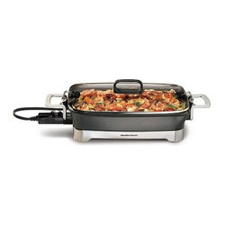 "Hamilton Beach - Hamilton Beach - 12"" x 16"" Nonstick Electric - Lid latches onto pan for easy pouring and storage. Built-in spout makes it easy to save or discard drippings and broth. Lid inverts inside pan and latches securely for storage. Temperature adjusts from warm to 400 degrees F. Warm setting is ideal for serving. Equipped with 1500 Watts of power for fast heatup. Die-cast aluminum pan offers excellent cooking performance. Nonstick on the inside and outside of pan. Durable die-cast aluminum handles and brushed stainless steel base"