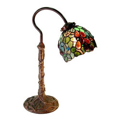 Warehouse of Tiffany - Grape Desk Lamp - Tiffany shade . In line switch. Uses one 25W light bulbs. Composed of 126 pieces of cut glass and 42 cabochons. Grapes have colorful Amber, Purple jewels and Green leaves. Base has a decorative grapevine details . Minimal assembly required. 13 in. L x 13 in. W x 19 in. H (8 lbs.)This accent table lamp has been handcrafted using methods first developed by Louis Comfort Tiffany. Each piece of stained glass is hand-cut, wrapped with fine copper foil, and then soldered together. Base has a decorative grapevine details with bridge like design in bronze finish. Grapes has colorful Amber, Purple jewels and Green leaves. Composed of 126 pieces of cut glass and 42 cabochons.