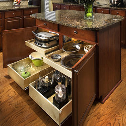Island - Total Access - Double height Glide-Out shelves help keep taller items from tipping over and are commonly used for storing appliances, vases, pots and other tall items. Single heights Glide-Out are perfect for storing cookware, bakeware and other 'low height' items.