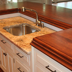 Cherry Wood Counter by Grothouse - Cherry Wood Stain Matched Kitchen Counter with Sink. Photography courtesy of Grothouse Lumber Co.