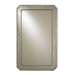Antiqued Wall Mirror - Sophisticated and chic, but with the grandeur of visual provenance in its antiqued frame, the Antiqued Wall Mirror has corners blunted and visibly tiled for a notable look. Within the simple, striking angles of the outline, the reflective pane is clear, while the frame offers a raised boarder which shows age in its silvering. This versatile mirror can be used to reflect suave transitional tables capes or hung over a traditional console or counter.