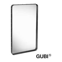Gubi Adnet Rectangular M Mirror - Adnet Rectangular Mirror is made from hand-stitched Italian natural tanned full grain leather in black or tan. It is covered in full grain leather with brass rivets. The mirrors can be used freestanding or mounted on the wall. The depth of the mirror frame is 6 cm. Wall mounts included.