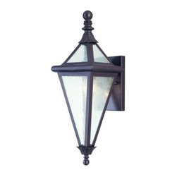 Troy Lighting - Geneva Outdoor Wall Mount by Troy Lighting - The Troy Lighting Geneva Outdoor Wall Mount adds a simplicity that hints at the elegant Victorian period. Featuring a Clear Seeded glass shade, hand-worked wrought iron construction and an Old Rust finish, the Geneva Outdoor Wall Mount is a diamond of light that sparkles with understated design. Troy Lighting, headquartered in California, designs and manufactures indoor and outdoor lighting fixtures, utilizing hand-forged iron and hand-applied finishes to create quality products with high-style appeal.
