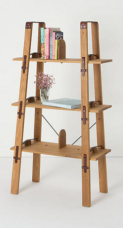 Attache Bookcase - Every living room worth its salt needs a place to house that burgeoning library, and this bookcase from Anthropologie will do the job without overwhelming a small space. With a narrower top and open back, this airy piece looks light and easy.