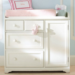Madison Changing Table - Our Madison Changing Table is distinguished by its smoothly rounded knobs, cleanly framed features and incredibly versatile design.