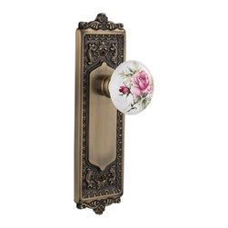 "Nostalgic - Nostalgic Passage-Egg and Dart Plate-Rose Porcelain Knob-Antique Brass - With its distinctive repeating border detail, as well as floral crown and foot, the Egg and Dart Plate in antique brass resonates grand style and is the ideal choice for larger doors. And, nothing says ""vintage"" like the traditional floral illustration of the White/Rose Porcelain Knob. All Nostalgic Warehouse knobs are mounted on a solid (not plated) forged brass base for durability and beauty."