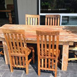 Rustic Reclaimed Teak Dining Table & Chairs - A very rustic teak dining table and chairs made from reclaimed old growth teak railroad ties / trestle bridge pieces.  Can be used indoors or outdoors.  The sun will bleach all wood, but the old growth teak is great for outdoor use!  Impact Imports can make a custom teak table for you!