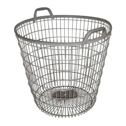 """Used Galvanized Steel Basket circa 1960s - This oversize, galvanized steel basket with handles features a versatility of use with vintage character to boot. For magazines and newspapers at sofa side, towels in the bath, significant potted plants and/or trees, laundry awaiting the wash, kids' toys, shoes, boots. You name it, put it to use, bringing style and flair to the humdrum of daily routines. Basket measures 22"""" high and funnels from 23.5"""" diameter at the top to 15.25"""" at the bottom."""