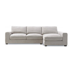 Kelley - Eggplant fabric sectional with right-arm chaise - Kelley is a fusion of our twin obsessions: exceptional comfort and high-style detailing. When sitting in Kelley, you immediately fall under the sway of its deep, soft seat, and luxurious cushions. With a generous mix of down, this sofa embraces you like a bear hug after a trying day.Kelley's arms are plush, with extra padding to support your head and back. And we fully extended the arm of the sofa's chaise to accentuate its leisurely intent. And because the sofa is so steadily constructed, both arms can easily serve as seating for guests.Kelley is available in a variety of fabric options, but we've selected one of our favorites as its standard option: a hefty and soft linen-textured blend, which is both comfortable and unselfconsciously stylish, and will hold up to years of enjoyment.  The eggplant fabric is a beautiful dark purple color with earthy tones.Dimensions: 108*65*33