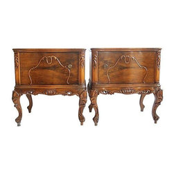 Vintage French Walnut Nightstands - A beautiful set of vintage French nightstands in walnut finish. The nightstands feature ornate carved details throughout with Queen Ann style legs. Both nightstands open to store your bedside treasures. The tables are in good vintage condition, with age appropriate wear to the tops.