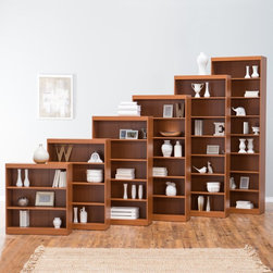 Finley Home - Remmington Heavy Duty Bookcase - Oak Multicolor - #9016-36 L02 - Shop for Bookcases from Hayneedle.com! Lighten up the load on your desk or coffee table with the Finley Home Remmington Heavy Duty Bookcase - Oak - it s the perfect place to stash books files photos and more. Crafted with durable MDF wood and veneers that resist warping this light oak-finished bookcase boasts sturdy reinforced shelves that hold up to 150 lbs. each. Choose from several heights with varying numbers of shelves most feature adjustable shelves so you can store bulky and small items alike. Assembly required. Available Sizes 36-Inch:32W x 12D x 36H inches3 fixed shelves 48-inch32W x 12D x 48H inches4 shelves: 1 and 3 are fixed; 2 and 4 are adjustable 60-inch32W x 12D x 60H inches5 shelves: 1 and 3 are fixed; 2 4 and 5 are adjustable 72-inch32W x 12D x 72H inches6 shelves: 1 3 and 5 are fixed; 2 4 and 6 are adjustable 84-inch32W x 12D x 84H inches7 shelves: 1 3 and 6 are fixed; 2 4 5 and 7 are adjustable 96-inch32W x 12D x 96H inches8 shelves: 1 3 and 7 are fixed; 2 4 5 6 and 8 are adjustable About Finley HomeFinley Home was created to ensure that your needs wants and desires regarding home furnishings and decor are met with ease. Offering a well-appointed mix of both current and classic designs all with functional style at exceptionally affordable prices Finley Home's unique pieces and collections are ideal for keeping pace with today's ever-evolving lifestyles. Simple silhouettes understated elegance and versatility define the Finley Home brand and make it one you'll return to for years to come.