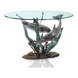 SPI - Cast Aluminum Dolphin Duet Glass Top Coffee Table - This spectacular brass glass top coffee table features a design of dolphins swimming through simulated sea grass. The glass top is 1/2 inch thick, with beveled edges. The table measures 22 inches high, 42 inches wide and 24 inches deep.
