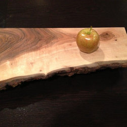 Cutting Board - Cutting Board - noun (1) a wooden board where meats, cheeses, or vegetables can be cut (2) something cool to display cheese, snacks, or interesting stuff worthy of display. Handmade. This is a special live-edge English Walnut board. This is part of the Spugnardi.com vast Military-Woodworking Complex Cutting Board Series from ALPHA to ZULU.