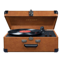 Crosley Radio - Keepsake USB Turntable in Tan - USB enabled for connection to windows equipped PC and MAC. Software suite for ripping and editing audio content. Belt driven turntable mechanism. Plays 3 speeds - 33 1/3, 45 and 78 RPM records. Plays 7 in., 10 in. & 12 in. records. Fully automatic return tone arm. Diamond stylus needle. Auxiliary input. Adjustable robe control. Dynamic full range stereo speakers. Vinyl-wrapped. Headphone jack. RCA out. Chrome snap closure. Corner guards. Metal and Resin handle. Portable. 11 in. L x 17 in. W x 7 in. H