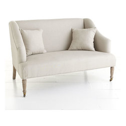 French Linen Settee - This settee's simplicity makes it a versatile seating option. The soft and simple curves provide an elegant backdrop to display bold or unique pillows, and the casters in the front are convenient for someone that loves a frequent rearranging! It comes with two pillows, but you can fill it with more to add a splash of color or for a quick update. It's such a cozy piece to look at and to lounge on.