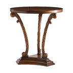 (88-718) Hampshire House Lamp Table - Originally made of wrought iron, this table was used in Dorothy Draper's design of the Garden Lounge at the Hampshire House, a residential hotel in New York City. The Hampshire House table features three highly stylized carved supports of a leaf design that is reminiscent of the 1940s, with carved scroll ends on each side of a three-sided stepped base. Made of Cherry.