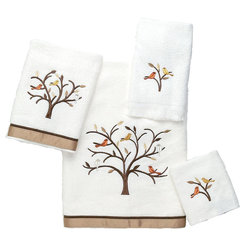 Avanti Linens - Friendly Gathering 4 Piece Cotton Towel Set by Avanti Linens - Friendly Gathering features a modern twist on a traditional bird design. Simple single-color metallic birds sit perched in a tree with metallic leaves. The bath and hand are trimmed in a solid copper border with brown trim. The color of the towels is white.