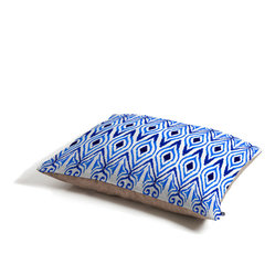 Amy Sia Ikat Blue Dog Bed - Perfect for dogs, cats…heck, even a pig! With our cozy pet bed made of a fleece top and waterproof duck bottom, you're bound to have one happy animal catching some zzzz's in ultimat