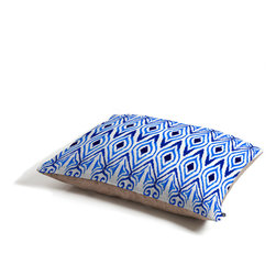 Amy Sia Ikat Blue Dog Bed - Perfect for dogs, cats…heck, even a pig! With our cozy pet bed made of a fleece top and waterproof duck bottom, you're bound to have one happy animal catching some zzzz's in ultimate comfort.