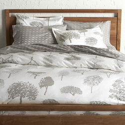 """Marimekko Rantapuisto Grey Full/Queen Duvet Cover - Global forest plants grey silhouettes of the world's trees on crisp white cotton percale bedding, artfully rendered in designer Fujiwo Ishimoto's painted design. Inspired by his observations of nature in many settings, the pattern is named Rantapuisto, a Finnish word meaning """"beach park."""" Reversible duvet cover has hidden button closure and interior fabric ties to keep the duvet in place. Duvet insert available."""