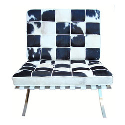 Barcelona Mid Century Eames Modern Chair - Classic Barcelona style chair.  New in beautiful black and white cow hide with a chrome like shine. This chair has everything it needs to deliver the maximum wow-factor! White leather buttons and welting define the checkerboard pattern.  The base is made of shiny polished aluminum and heavy duty white leather straps. Buckles and straps fix the seat cushion while straps and snaps fix the back cushion so neither slides off. Zippers on the white leather backs of both cushions allows access to the foam stuffing.