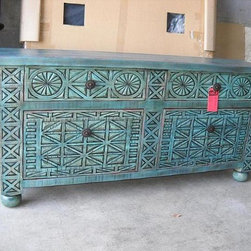 Turquoise finish handcarved buffet - This may be too risky for some but this client was thrilled.  Handcarved knotty alder with a custom turquoise finish.