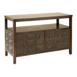 Currey & Company - Tramp Art TV Console - Inspired by the American crafts movement of the late 19th century and early 20th century, this new collection consists of lighting and furniture created by hand. A popular movement during this time period was Tramp Art. All that was needed to create Tramp Art was patience, imagination, and a penknife. Currey & Company has reclaimed the tramp art method in a new way but with similar technique and materials. This TV console is a wonderful example of wood notching associated with Tramp Art. Made of wood, this piece has the appearance of an authentic product from the 1920's.Wipe spills immediately with soft dry cloth. Always use coasters or mats. Never place cups, glasses or anything hot directly on the surface. This could cause discoloration.