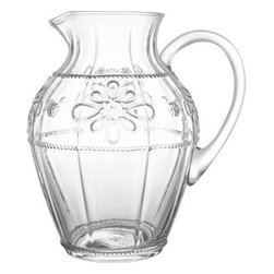 """Juliska - Juliska Colette Pitcher Clear - Juliska Colette Pitcher Clear. Sure to become one of your favorite vessels, this versatile pitcher looks equally fetching filled with pink lemonade or a bouquet of peonies. Flirtatiously trimmed with Collette medallions, a sprinkling of berries, and a bit of beveling, for adornment. Dimensions: 9.5"""" H Capacity: 2.75 Qt"""
