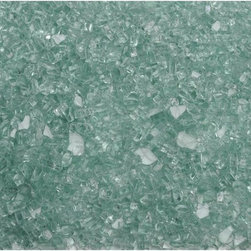 American Fireglass Solex | 1/4-in Fire Glass | 1 Lb - AFF-SOLX American Fireglass 1/4 Inch Solex Fire Glass - 1 Lb American Fireglass 1/4 Inch Solex fire glass iavailable in our Classic Collection. It is a soft color with a light green tint and looks great in a room with light green walls. Solex is also very nice when added to a fire pit near a pool or outdoor garden because it adds a touch of elegance to your outdoor design.  Specifications: