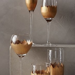 """Marchesa by Lenox - Lusa Glassware - Gold-plated glass. Handwash. Imported. Red wine: 14 oz. 9""""H, 3.25"""" diameter. White wine: 12 oz. 9""""H, 2.75"""" diameter. Flute: 8 oz. 11""""H, 2"""" diameter. DOF: 18 oz. 4""""H, 3"""" diameter. Highball:. 20 oz. 6""""H, 3"""" diameter"""