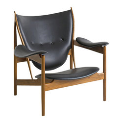 OneCollection - Finn Juhl Chieftains Chair | Danish Design Store - The Chieftains Chair was designed by Finn Juhl in 1949 and today is an icon within Danish furniture art. The Chieftains Chair is in itself a space filled with symbols inspired by weaponry and customs from foreign shores. Made by the very best craftsmen in teak and walnut, this chair now exudes extreme grandeur. It is upholstered in leather.