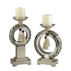 Chrysanthemum Decorative Candleholder - Set of 2 - With geometric bases, tasseled ropes, and metallic floral design, the Chrysanthemum Decorative Candleholder - Set of 2 lends style and grace to your home. Each in this set of two Polyresin candleholders has a brushed silver squared base topped with an O-shaped, mirror-ringed center piece. Gold and bronze Chrysanthemum flowers with silver leaves are accented by two-tone gold and silver ropes. Comes complete with two white, vanilla scented pillar candles.About Ore International, Inc.Ore International, Inc. creates beautiful accent furniture, lighting, and gifts for the home. Their goal is to be the leading provider of innovative, superior home products worldwide. Ore International is based in Santa Fe Springs, California and has a Customer First attitude. Their products are designed to match modern and classic tastes and fit today's homes. From room dividers to lamps, end tables to entertainment centers, you'll discover quality craftsmanship at a fair price in all Ore International products.