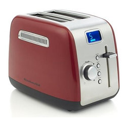 "KitchenAid® Red 2-Slice Toaster - High-performance and durability define this all-metal modern toaster with that signature KitchenAid style and engineering. Toasting slots auto-adjust for thick or thin slices, with extra-wide 1.5"" maximum capacity to accommodate thick bagels, breads and pastries. Foods are held upright while the extra-deep steel toasting cavity delivers even browning. Options include defrost, reheat and bagel—the latter reducing toasting power by half on one side, creating the perfect bagel (gently brown on the outside and golden brown on the cut side). Defrost button allows you to toast frozen pastries to perfection in minutes. Reheat button warms toasted food in under one minute. Digital readout with progress bar and countdown timer remembers previous shade and function settings. High-lift lever raises even the smallest foods for easy retrieval."