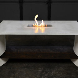 Gaussian Fire Table - A variation of one of our original concepts, the Gaussian fire table is a monolithic, 1-inch-thick, glass-fiber-reinforced concrete (GFRC) table with a rectangular top and sides that follow a bell-shaped curve from a straight line at the top to an arc at the bottom. It features an 18-inch-wide, full-length walnut shelf that engages the table legs through precisely figured slots. A locking peg on each end of the shelf prevents it from sliding out of place while adding a nice decorative touch.