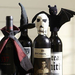 "Witch Hat Bottle Topper - Dress up your Halloween festivities with these fun bottle toppers. Bat: 9"" wide x 1"" deep x 5"" high Skull: 3"" wide x 3.5"" high Bat is hand made of velvet polyester. Skull is hand knit."