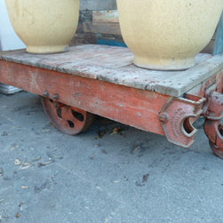 Antique Wood Cart with Metal Wheels - I like re-purposing anything, and a cart like this could be another option for a coffee table in a wine room.