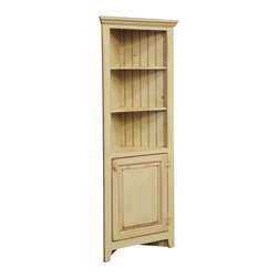Chelsea Home Furniture - Chelsea Home Beth 28 Inch Corner Cabinet fits 18 Inch Wall - This beautifully constructed solid pine Beth Corner cabinet, shown in Buttermilk finish, adds sophistication and functionality to any unused corner of your home. With 2 display shelves and a paneled cabinet door, this clean-lined piece compliments kitchens or living rooms in need of extra space and country character. Chelsea Home Furniture proudly offers handcrafted American made heirloom quality furniture, custom made for you. What makes heirloom quality furniture? It's knowing how to turn a house into a home. It's clean lines, ingenuity and impeccable construction derived from solid woods, not veneers or printed finishes over composites or wood products _ the best nature has to offer. It's creating memories. It's ensuring the furniture you buy today will still be the same 100 years from now! Every piece of furniture in our collection is built by expert furniture artisans with a standard of superiority that is unmatched by mass-produced composite materials imported from Asia or produced domestically. This rare standard is evident through our use of the finest materials available, such as locally grown hardwoods of many varieties, and pine, which make our products durable and long lasting. Many pieces are signed by the craftsman that produces them, as these artisans are proud of the work they do! These American made pieces are built with mastery, using mortise-and-tenon joints that have been used by woodworkers for thousands of years. In addition, our craftsmen use tongue-in-groove construction, and screws instead of nails during assembly and dovetailing _both painstaking techniques that are hard to come by in today's marketplace. And with a wide array of stains available, you can create an original piece of furniture that not only matches your living space, but your personality. So adorn your home with a piece of furniture that will be future history, an investment that will last 