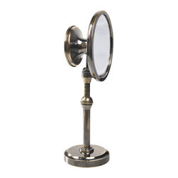 "Inviting Home - Vanity Magnifying Mirror - magnifying mirror with large slightly magnifying concave front and smaller flat mirror back; 3-1/2""x 5"" x 13""H The vanity magnifying mirror has traditionally vacillated between the ornamental and practical. Huge and over decorated wall mirrors have been de rigueur for centuries. Strangely enough it�s hard to find a modest practical table mirror made with both ease of use and aesthetics in mind. A synthesis of form and function this magnifying mirror stands on a base replicating part of a Georgian scientific instrument. Vanity mirror telescopes up and down. This magnifying mirror angles by adjusting a clever ball-joint. Sleek and classy mirror has large slightly magnifying concave front and smaller flat mirror back"