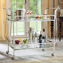Frontgate - Cosmopolitan Bar Cart - Park in a living or dining room throughout the year and top with interesting bottles and glasses. Rolling casters make it easy to keep the party mobile. Also can be used as a serving trolley. Tempered glass shelving is easy to clean. Assembly required. You'll be the toast of the cocktail party when you wheel your finest spirits and barware into the room on this generously sized, two-tier Cosmopolitan Bar Cart. The sophisticated, nickel-plated frame supports a pair of tempered-glass shelves with ample room for bottles, glasses, bar tools, ice, and nibbles.  . .  .  . . A Frontgate exclusive..