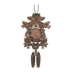 RIVER CITY CLOCKS - Eight Day Hunter's Cuckoo Clock with Hand-carved Oak Leaves, Animals, Rifles, an - This traditionally styled German cuckoo clock features wooden hands, a wood dial with Roman numerals, and a warm light yellow hand-painted and hand-carved cuckoo bird.     The cuckoo clock case is surrounded by many carved oak leaves with a hand-carved deer head with antlers at the top of the clock. There is also a hand-carved rabbit and bird on each side of the clock dial. Two cast iron pine cone weights are suspended beneath the clock case by two separate brass chains.    The hand-carved painted oak leaf pendulum continuosly swings back and forth which controls the timing of the clock. If your cuckoo clock's timing should ever need adjustment, you can control the speed of your clock by sliding the oak leaf up or down the pendulum stick. Sliding the oak leaf down causes the cuckoo clock to run slightly slower, while sliding the oak leaf up makes the cuckoo clock run slightly faster.    On every hour the cuckoo bird emerges from a swinging door above the clock dial and counts the hour by cuckooing once per hour. (Example: At one o'clock the bird will cuckoo once. At eight o'clock the bird will cuckoo eight times) The half hour is announced with one cuckoo call.     The eight day mechanical movement, which is produced in the Black Forest of Germany, is wound once per week by raising the two pine cone weights. One weight powers the time and the other weight powers the cuckoo and cuckoo call.    *Great effort has been made to portray each cuckoo clock as accurately as possible. As with many handmade items, the exact coloration and carving may vary slightly from clock to clock. We consider this to be a special part of their character. This clock is covered by a two year limited warranty covering workmanship and manufacturers defects. .
