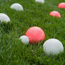 Belham Living - Field Club Noctilucent 100mm Bocce Ball Set - Glow in the Dark Multicolor - 80-1 - Shop for Backyard Games from Hayneedle.com! Turn bocce into a game della sera with the amazing Field Club Noctilucent 100mm Bocce Ball Set - Glow in the Dark. This high-quality bocce set has eight 100mm resin balls designed for high-level play in some unique colors: pink and white by day glowing green and orange by night! Everything about this set is what you'd expect from competitive equipment with a 50mm (also glow-in-the-dark) pallino and zippered heavy-duty terylene carrying bag. It's most likely the best outdoor party game of all time why stop when the sun goes down? Bocce Ball Materials and Sizes Resin is the most popular material for bocce balls and will withstand frequent use better than other materials. Molded plastic is best for children or for beginners and can be somewhat softer although still very durable. A bocce ball that is smaller than 100mm is typically best for children or for beginners. This size is easiest to handle and toss. Tournament balls will range between 107mm and 115mm. The International Standard ball is 107mm (4.2 inches) and weighs 920 grams (2 lbs.). The occasional backyard player will most likely appreciate a size somewhere between 100mm and 110mm.About Belham LivingBelham Living builds catalog-quality furniture in traditional styles at a price that actually makes sense. By listening to our customers and working closely with great manufacturers we build beautiful pieces worthy of your home. Rich wood finishes attention to detail and stylish lines that tie everything together are some of the hallmarks of a Belham Living piece. From the living room or bedroom through the kitchen and out onto the deck there's something from an incredible Belham collection perfect for your style.