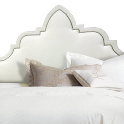 Baruch Headboard - This elegantly curved fully upholstered headboard will become the focal point of any sophisticated bedroom. The nail head trim beautifully outline the Moorish inspired profile.
