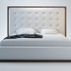 Ludlow Contemporary & Modern Bed by ModLoft - The awe-inspiring Ludlow leather bed commands instant attention when entering a room. The lavish button-tufted leather headboard stands five feet tall, elegantly framed in a wood border to match any decor. The smooth leather headboard seamlessly blends into its matching leather base with a wood border along the bottom edge. The mattress sits snuggly atop a solid pine-slat base for stylistic durability and added comfort. Platform height measures 14 inches (3 inch inset). Available in California-King, Standard King, and Queen sizes. Color combinations available in Wenge/White, Wenge/Grey, or Walnut/White. Bonded leather material. Assembly required. Mattress not included. Imported.