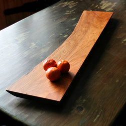 Natural Edge Serving Boards: Cherry - 60nobscot's Serving Boards from shop scraps & cut-offs are chosen for the character of their grain, figure, shape and color making them perfect for serving Sushi, Cheese, Bread or any other use that demands a striking presentation. They are all on felt covered feet to allow them to be scratch free on other fine surfaces.