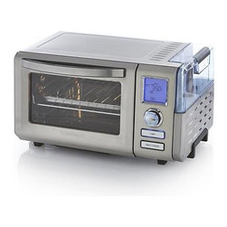 "Cuisinart® Steam Convection Oven - Professional-quality countertop convection oven with ultra-modern design and full steaming capability has nine functions for optimal baking, broiling, steaming, poaching or reheating foods. From beautiful roasts to proofing bread to fluffy steamed rice, this versatile oven can hold a 4.5-pound chicken or a 12"" pizza. Convection baking reduces cook-times up to 40%. Removable drip tray, wire rack, baking pan, broiling rack and crumb tray are included."