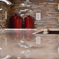 Riverwoods Remake - -brushed nickel Delta faucet graceful & rugged
